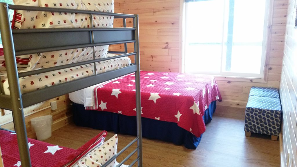 Here's one of the 3BR-BA suites with both Queen bed + Twin Bunkbeds.