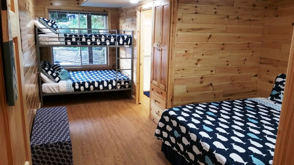 Of the 11 BR-BA suites, 2 of them have a Queen bed, Full Bunkbed + twin Bunkbed (not visible in this photo)