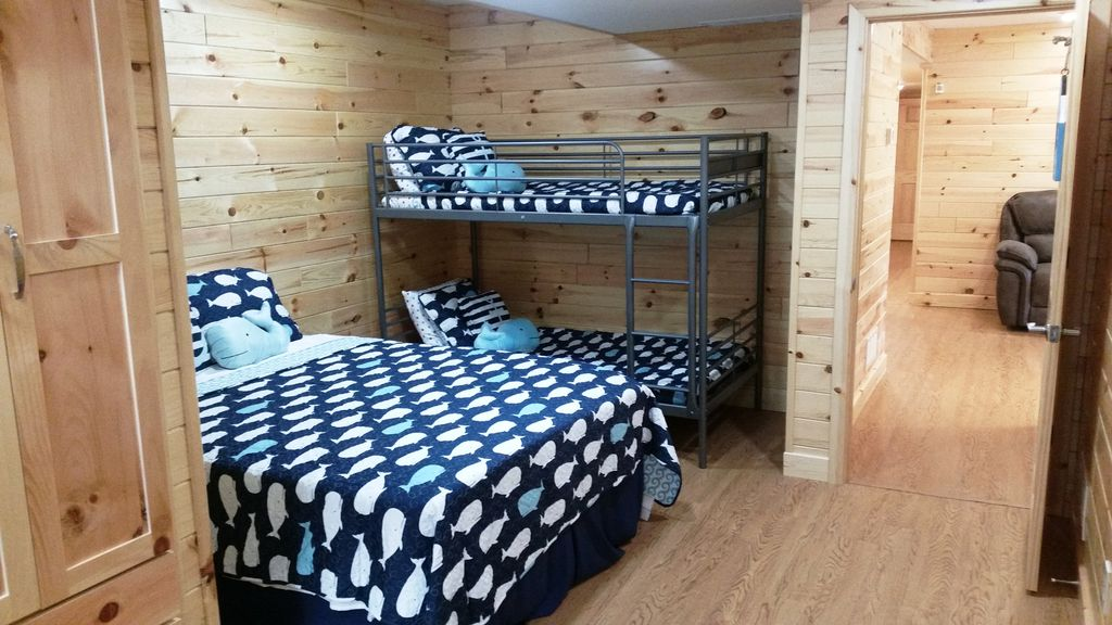 Another view of one of the 2BR-BA suites w/ Queen bed, + Full & Twin Bunksbeds.