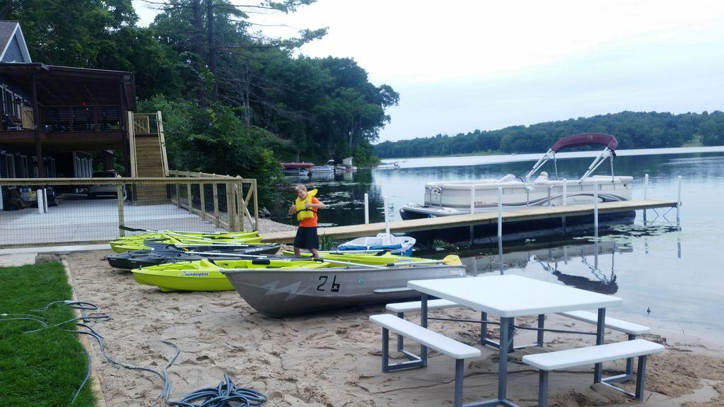Sandy gentle-slope beach is 80 ft long x 20 ft wide. Kayak racks to come.