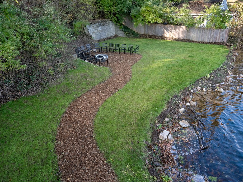 Firepit area great for yard games like cornhole. Shoreline clean-up scheduled!