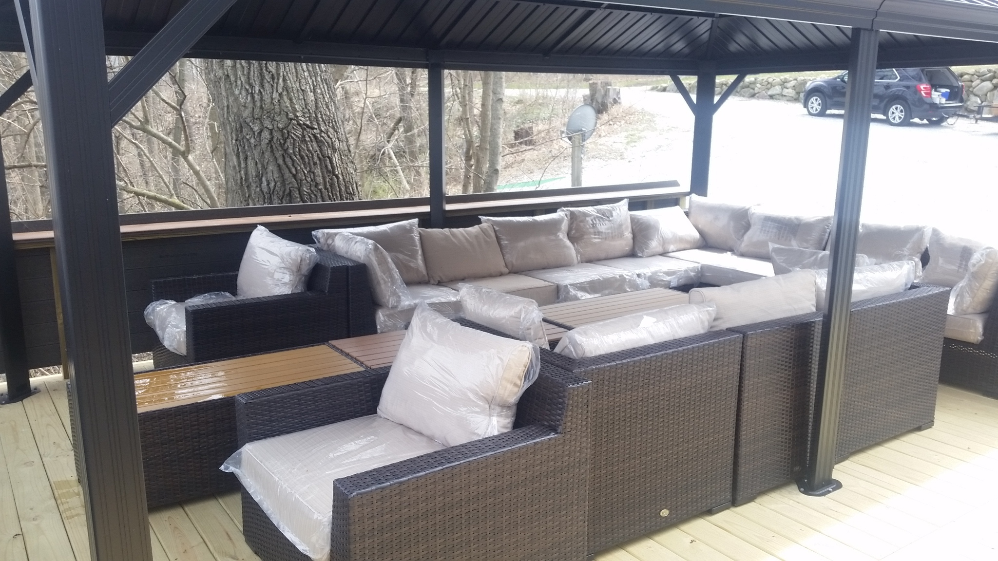 New comfortable outdoor sofas under the 12x20' gazebo. Seats 14+ friends and family.