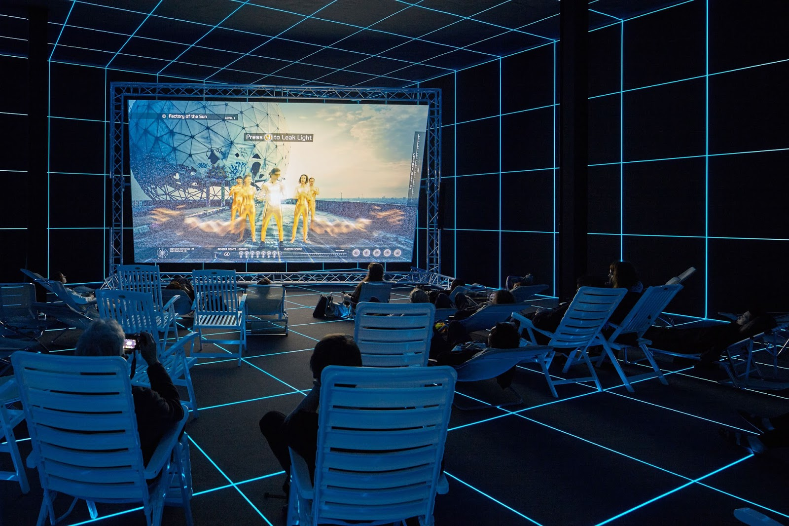 Hito Steyerl (b. 1966), Installation view of Factory of the Sun, 2015 (German Pavilion, 56th Venice Biennale, 2015). Video, color, sound; 21 min., looped; with environment, dimensions variable. Collection of the artist; courtesy Andrew Kreps Gallery, New York. Photograph by Manuel Reinartz; image courtesy the artist and Andrew Kreps Gallery, New York