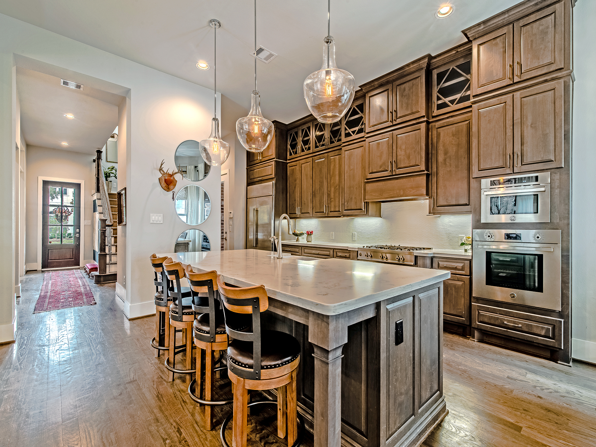 Kitchen features custom, ceiling height cabinetry and Bertazzoni appliance package.