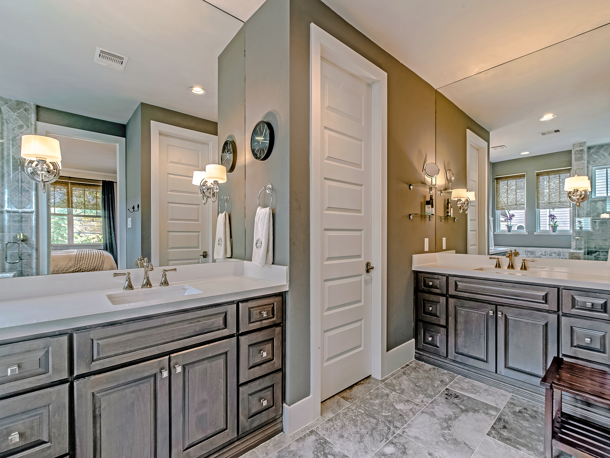 Ensuite master bath with double vanities, soaker tub and shower.
