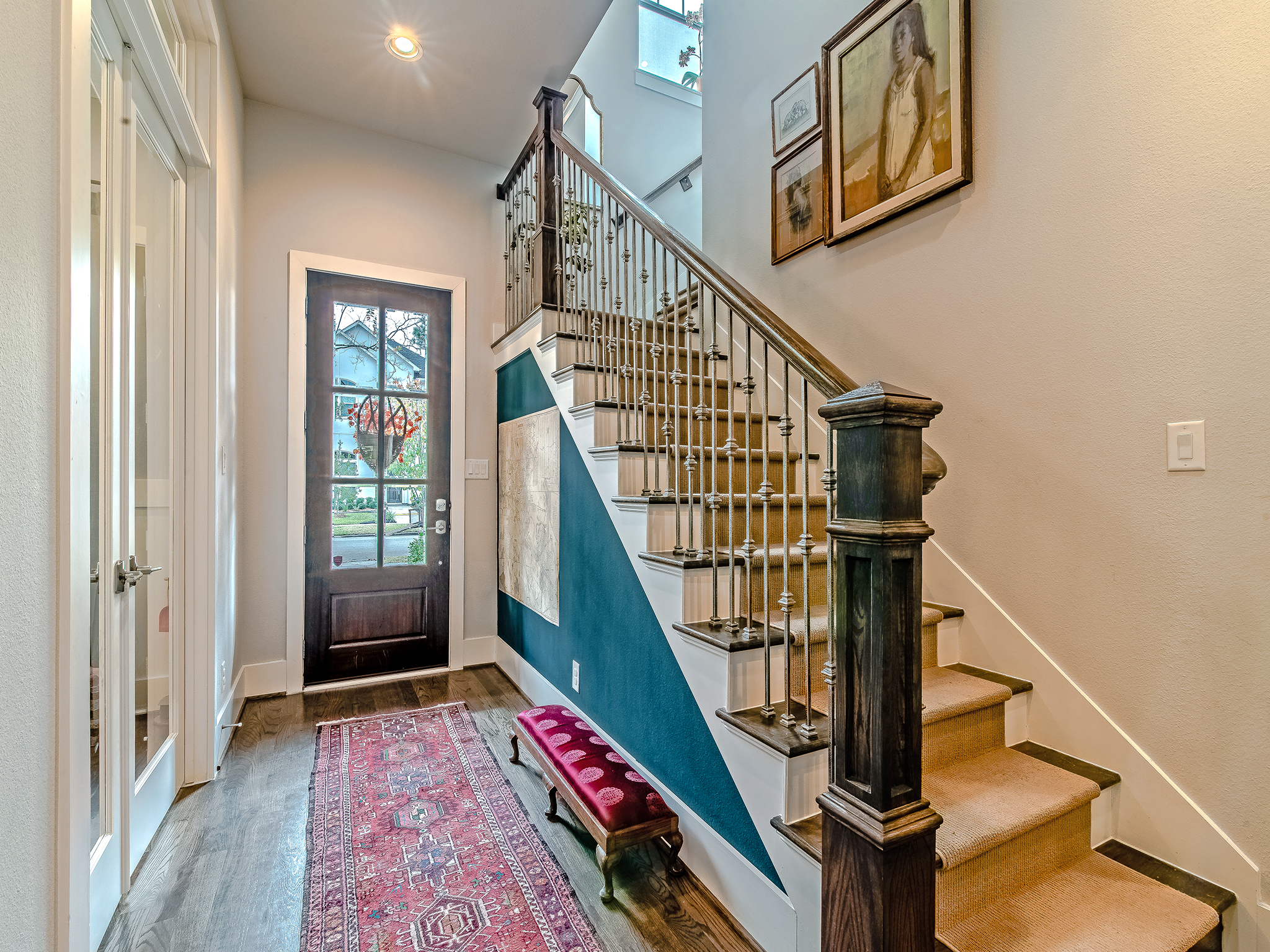 Inviting entry features gleaming hardwoods, soaring ceiling and wrought iron stair case. Just off the entry is an office space that is currently being used as a playroom.