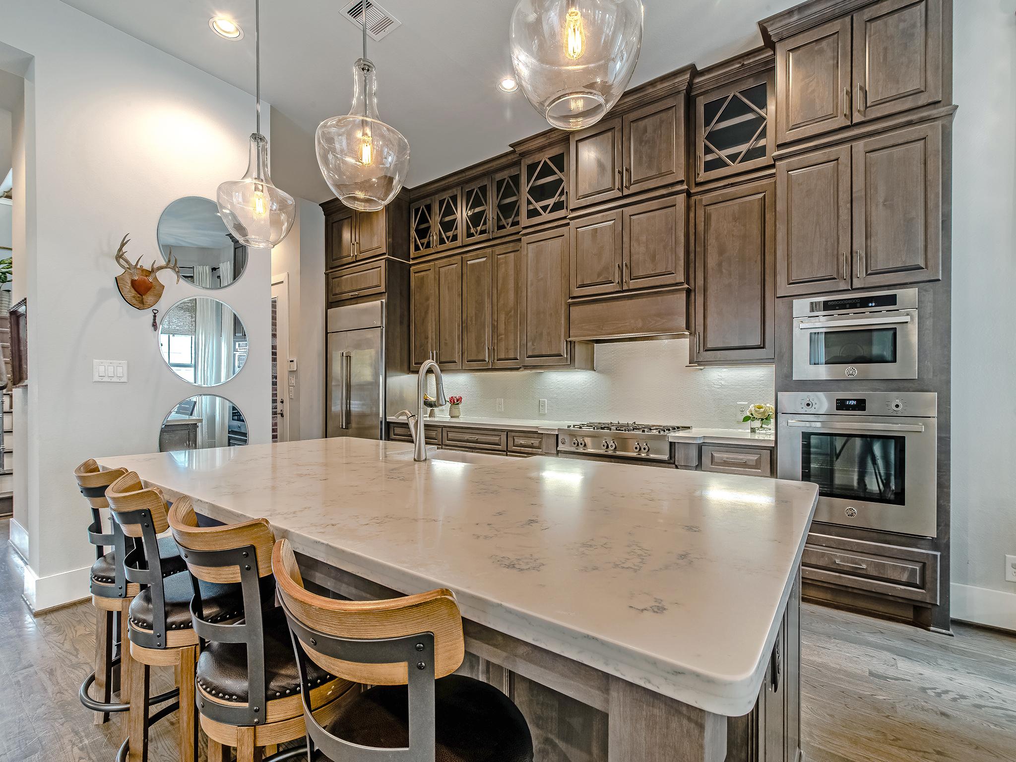 Kitchen also features quartz counters and a porcelain farm house sink.