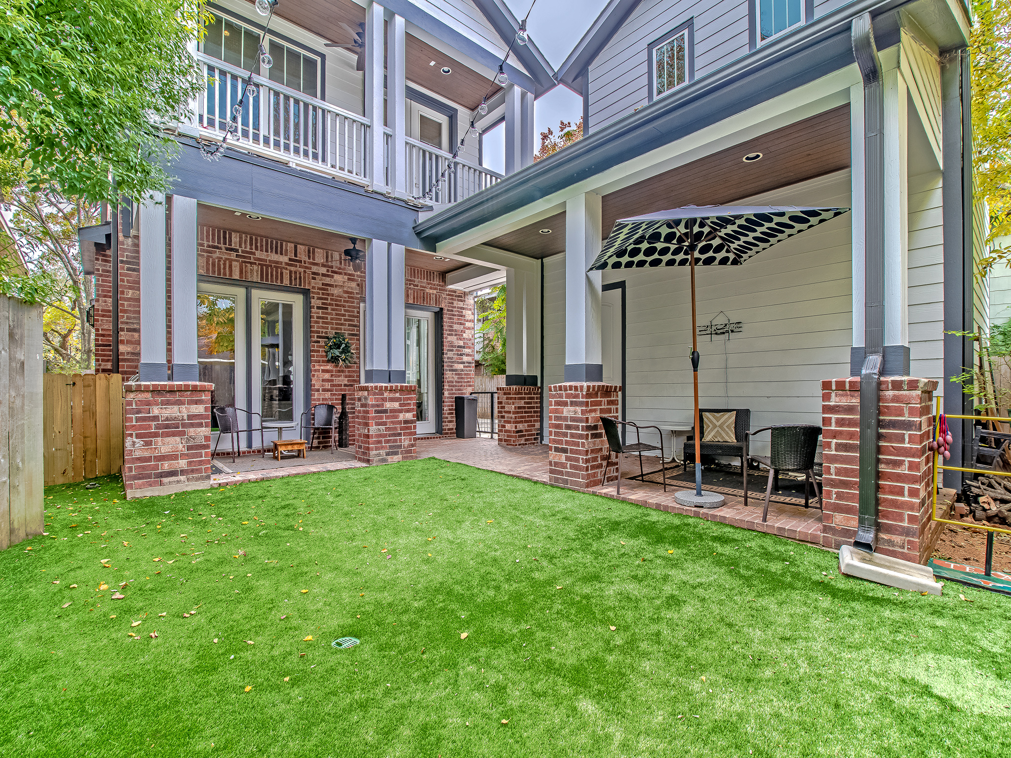 This backyard view shows the detached two car garage with ample storage space inside. Also features an unfinished space above the garage that would make a wonderful rental unit, game room or quarters for visitors.
