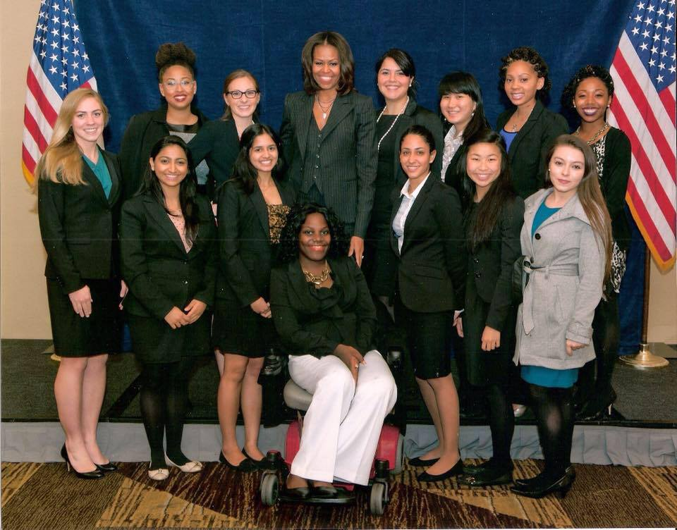 ola ojewumi with Michelle Obama and female volunteers