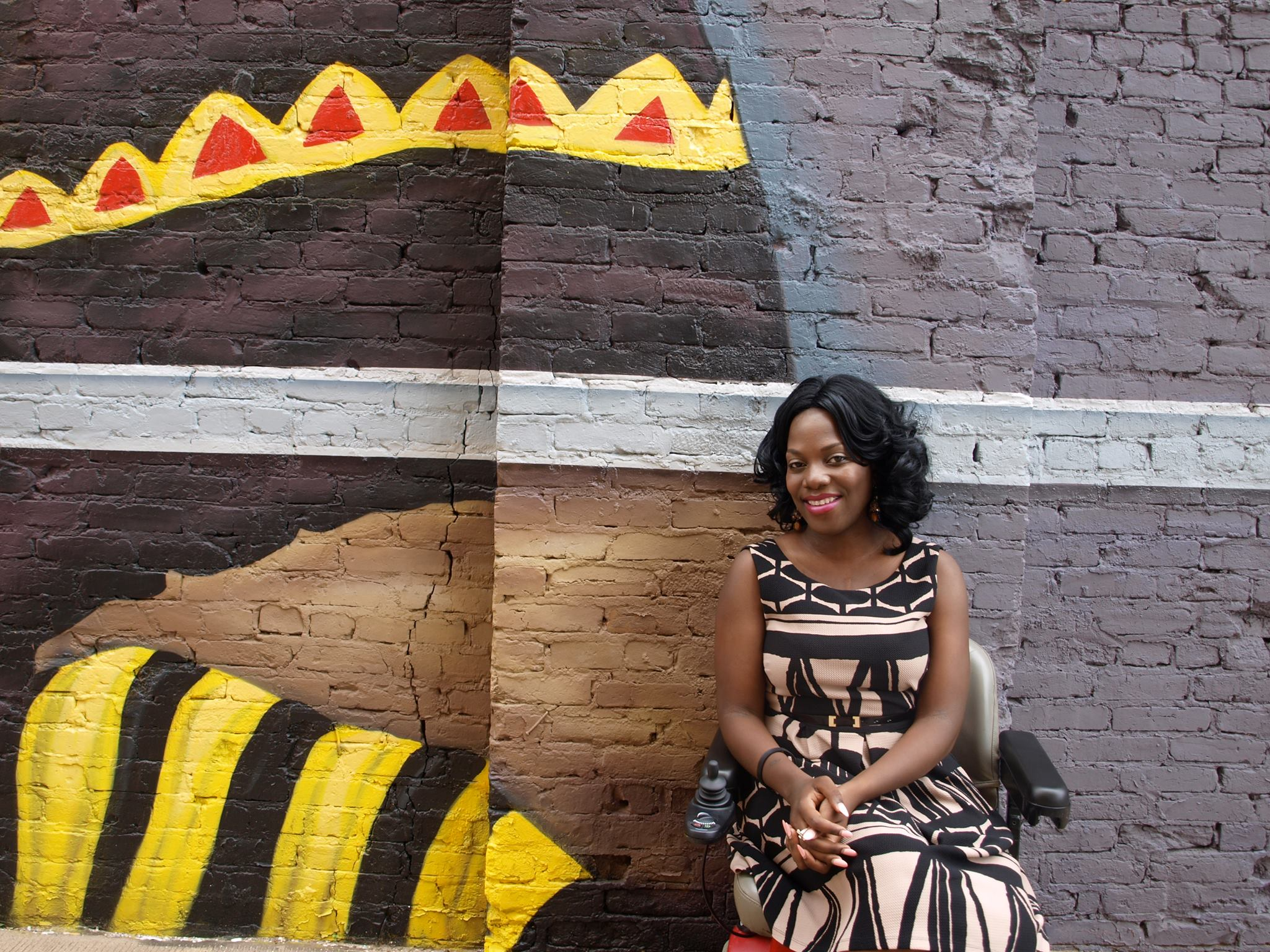 ola ojewumi in front of graffiti wall