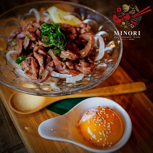 """Minori Style Yukke"" Korean-style Prime Roast Beef topped with Waimana TKG Egg Yolk, Green Onion, Onion, Sesame Oil, Lemon, and Steak Sauce."