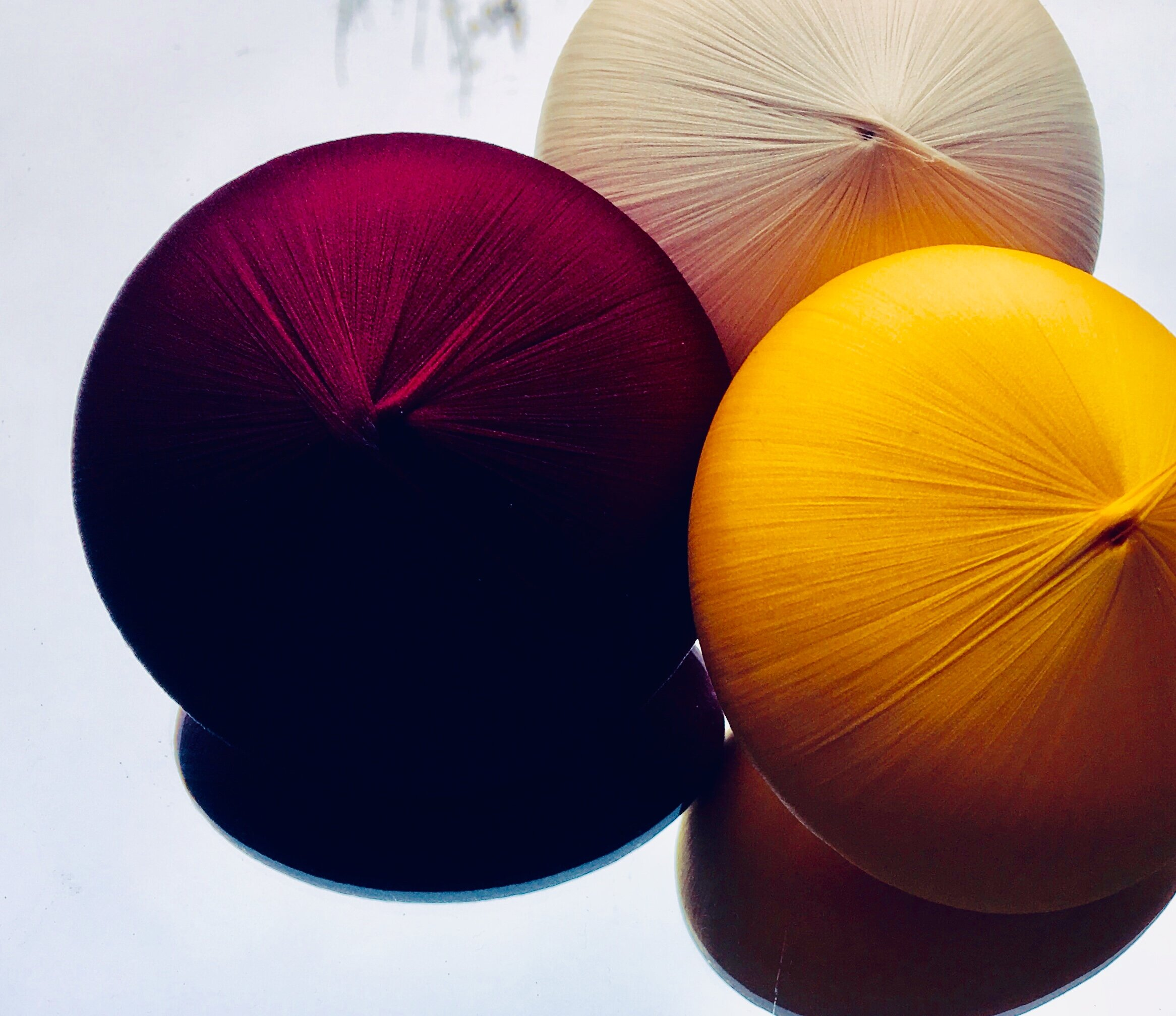 SATIN shapes - the big Saturn in the colours wine, sunflower and ivory