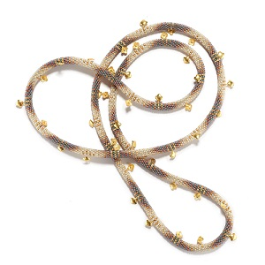 """Spring Candide Necklace. 2018.   Cylindrical glass beads, 18K yellow gold clover charms. 44"""" (111.76cm) length .25"""" (.63cm), .50"""" (1.27cm) width."""