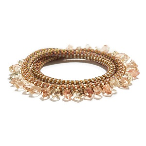 """Double Sunstone Bracelet/ Double 'Lyda' patterned bracelet   33 champagne and pink colored sunstones from south eastern Oregon. 16"""" (40.64cm) total length 7.5"""" (19.05cm) doubled length 3/4 to 1"""" (1.905 to 2.54cm) wide."""