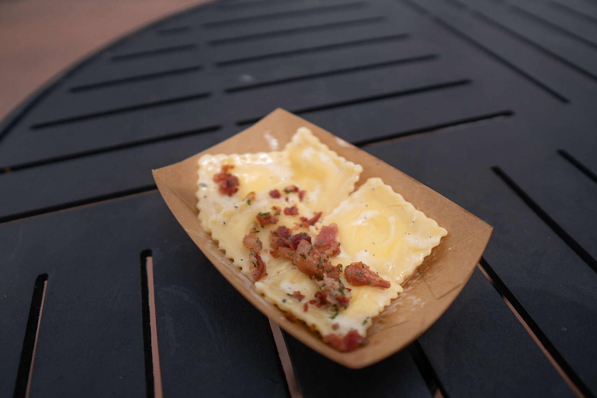Italy: Ravioli Carbonara: Parmesan and Pecorino Ravioli, Egg Yolk, Cream and Bacon