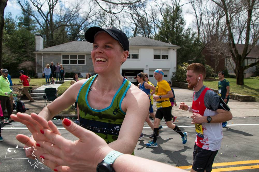 Our friend Kristen, getting a high-five at Mile 18 of the Boston Marathon.