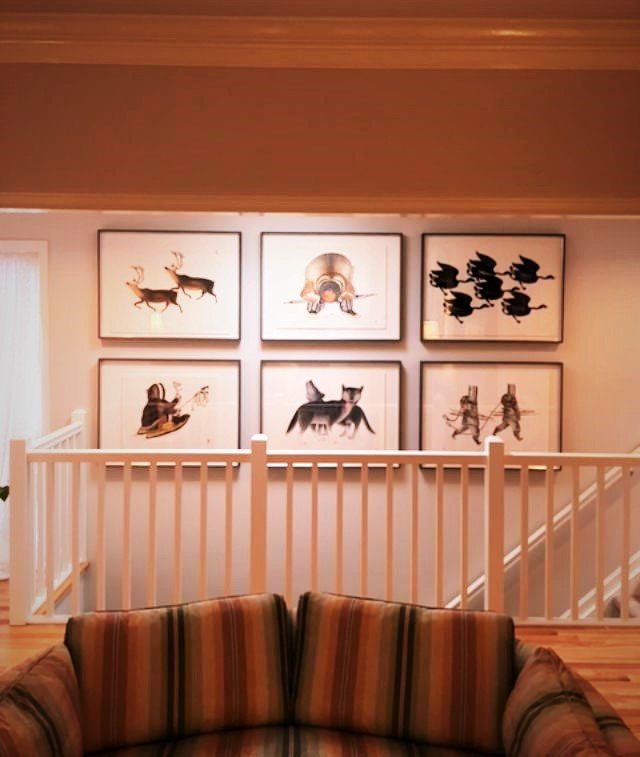 Original Inuit Woodcuts on Rice Paper. Art lifted and floated on 4 ply rag matt with museum glass