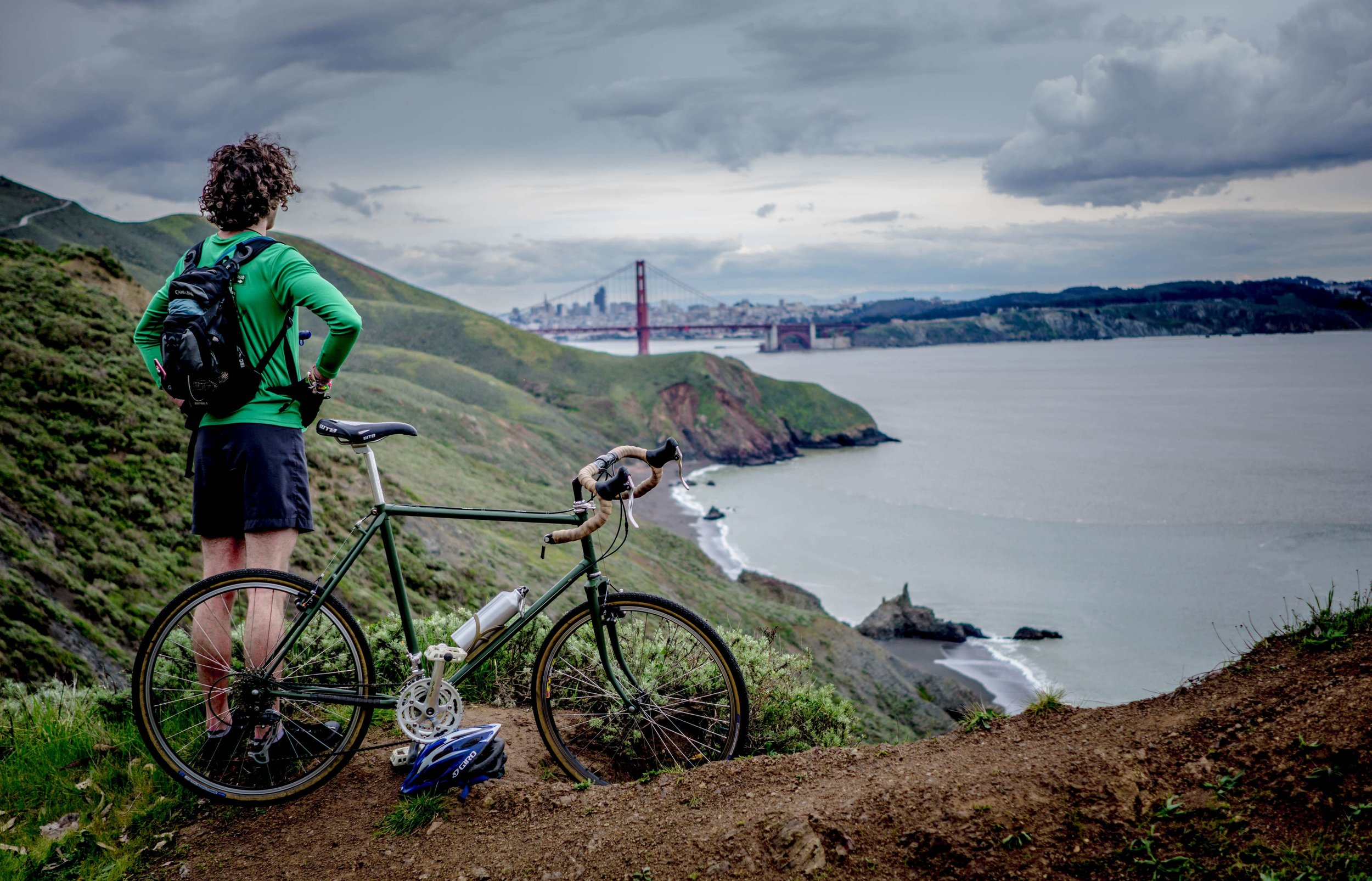 guy on bike looking at san francisco bridge