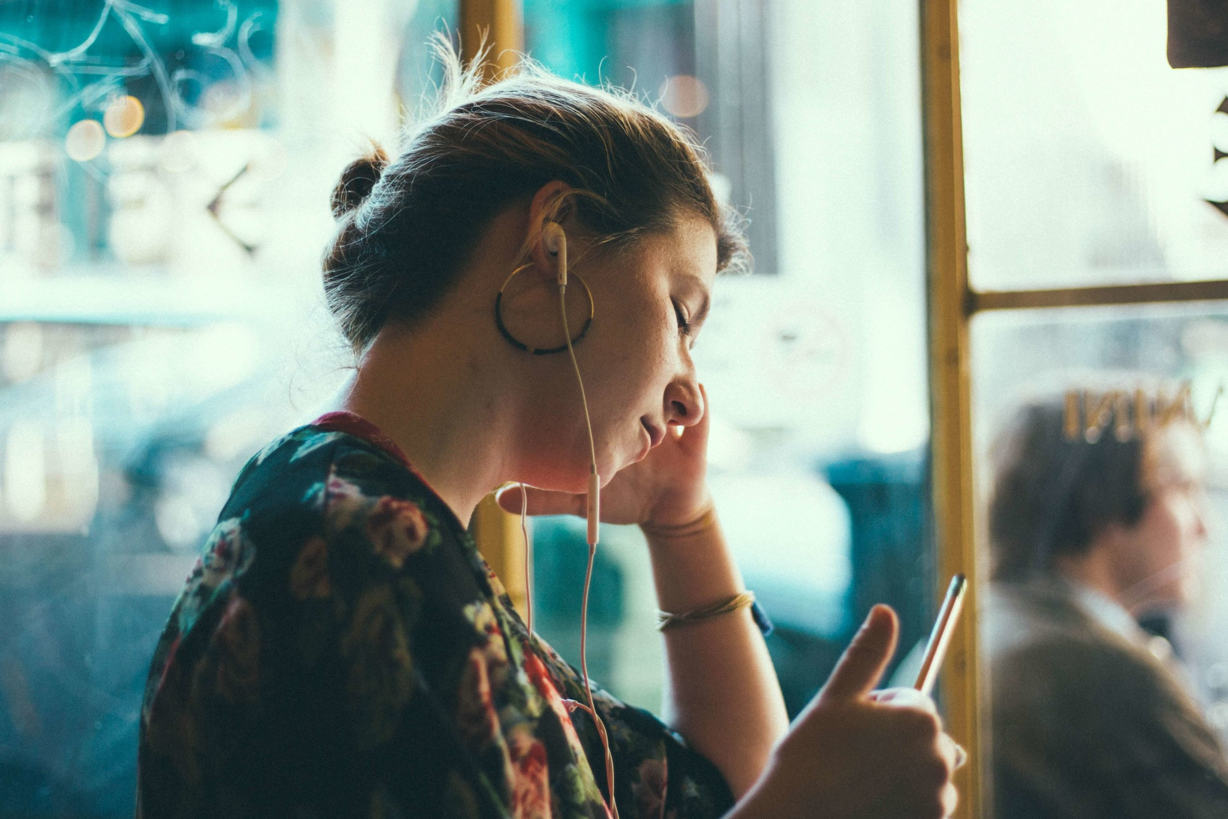 Young woman listening to health podcast