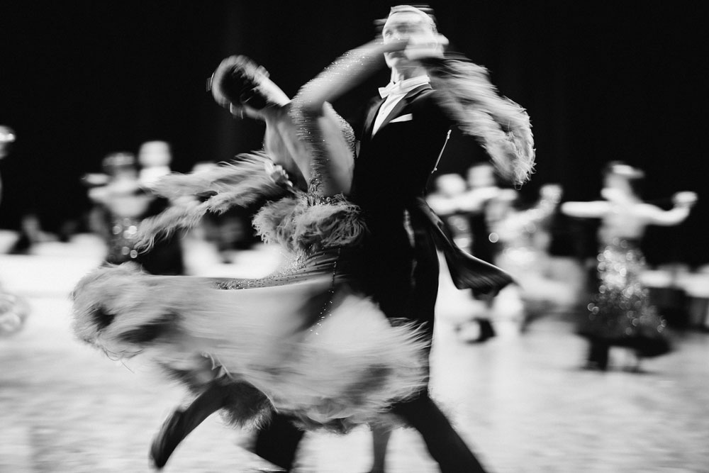 coupledancersballroomdancingblurredmotionblack-and-whiteimage.jpg