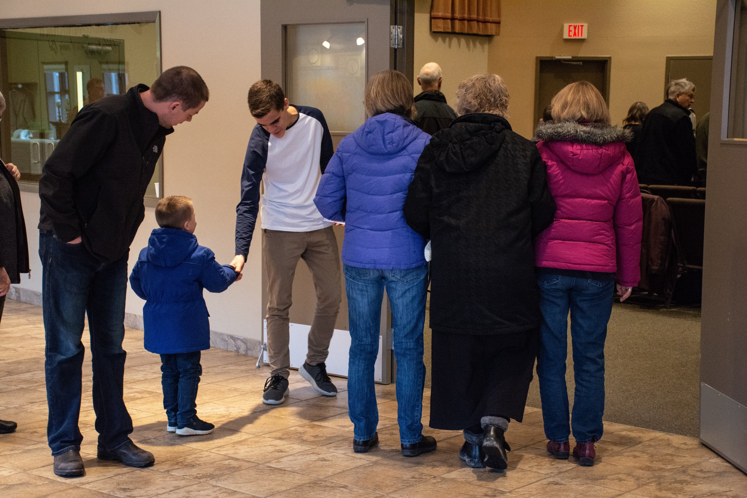 Greeting those entering the worship service at Nechako Community Church