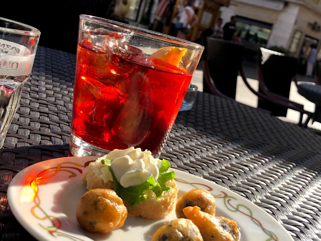 why can't I remember this oh-so-memorable moment? - How can I go back if I don't know which country, region, city or piazza it was where I sunset'd with fried olives and the perfect Negroni.
