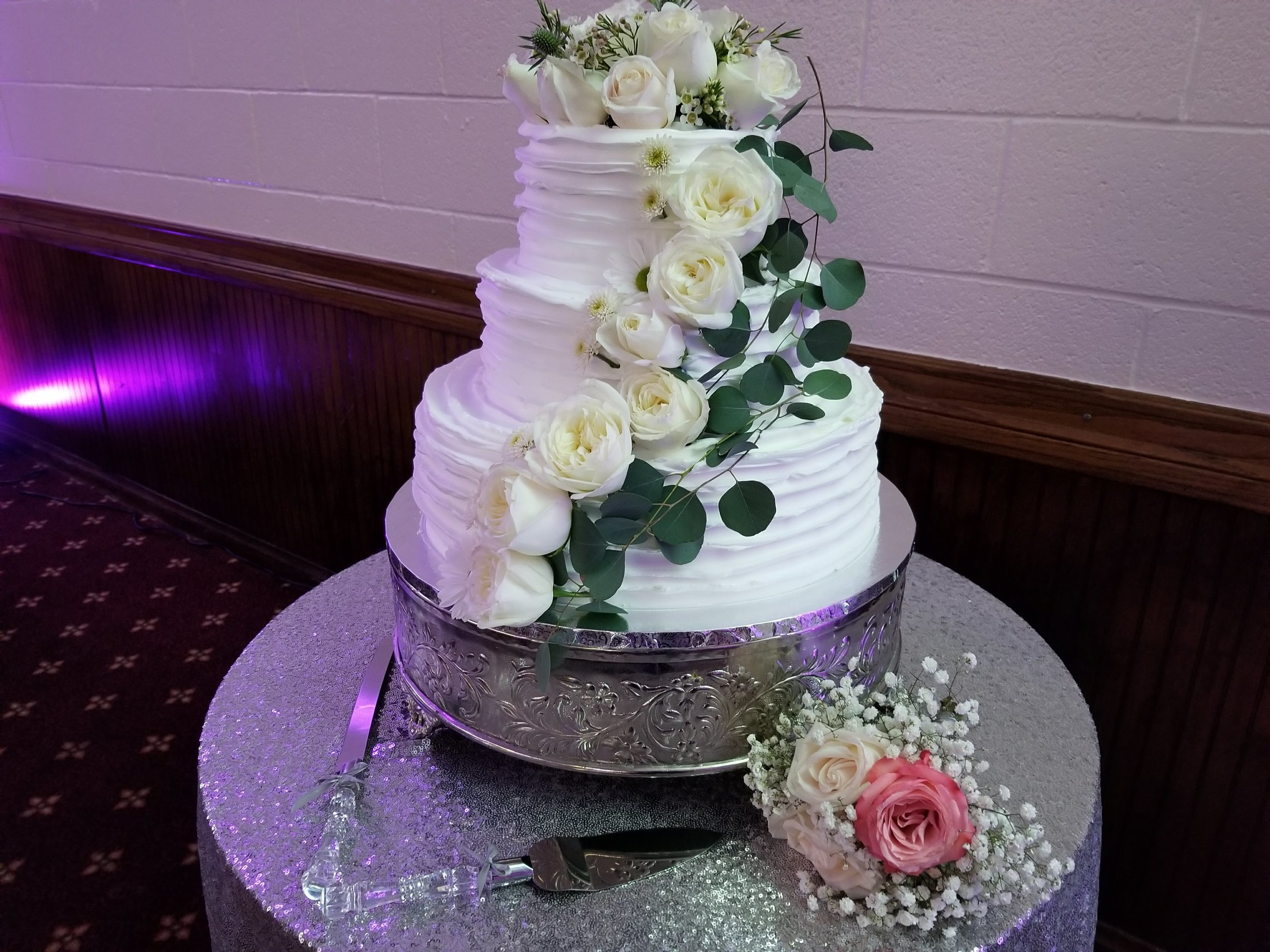 We added fresh flowers to the plain white cake to dress it up and add that romantic element.
