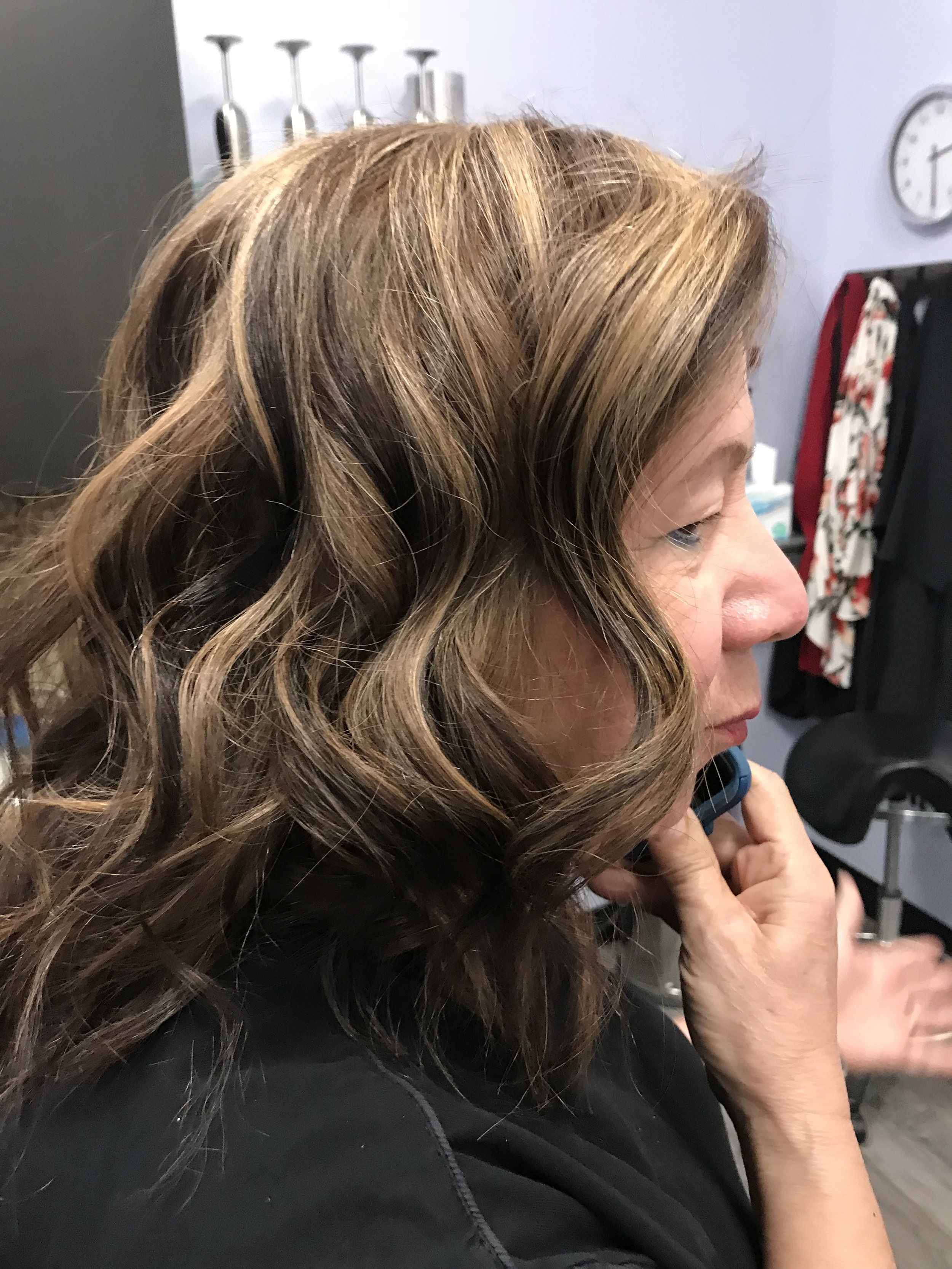 This is one of Linda's after photo's from her balayage procedure. We did a color retouch on Linda, lowlights for depth and dimension and balayage for the lighter tones in her hair. We did tone the lighter shades.