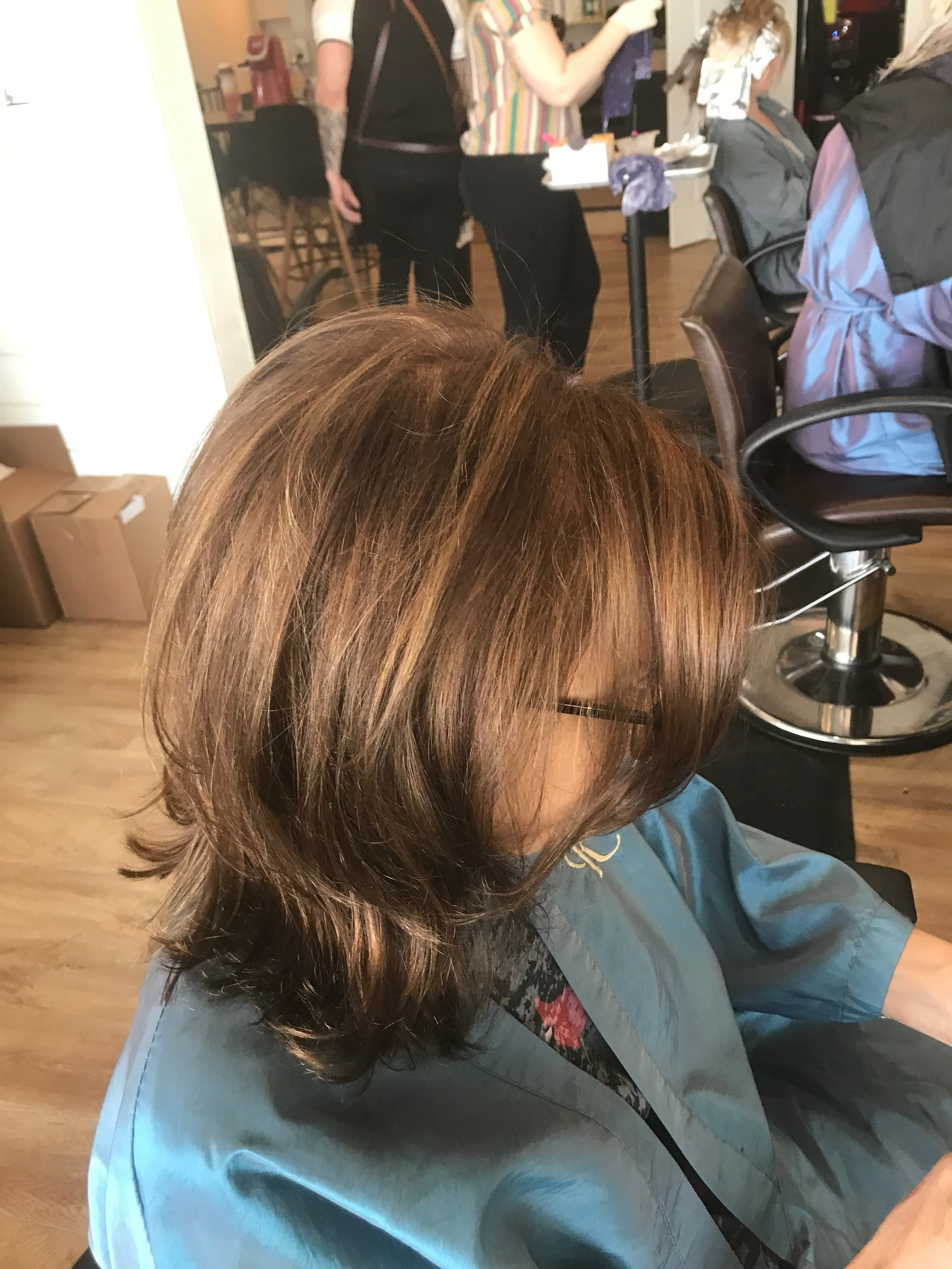 On Beth's most recent visit we took up the length a bit and with the new Aloxxi Color I am now using we adjusted the red a bit and gave her a more brown golden tone with little hints of copper.