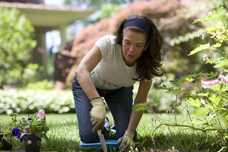 16337-a-woman-enjoying-gardening-outdoors-pv.jpg