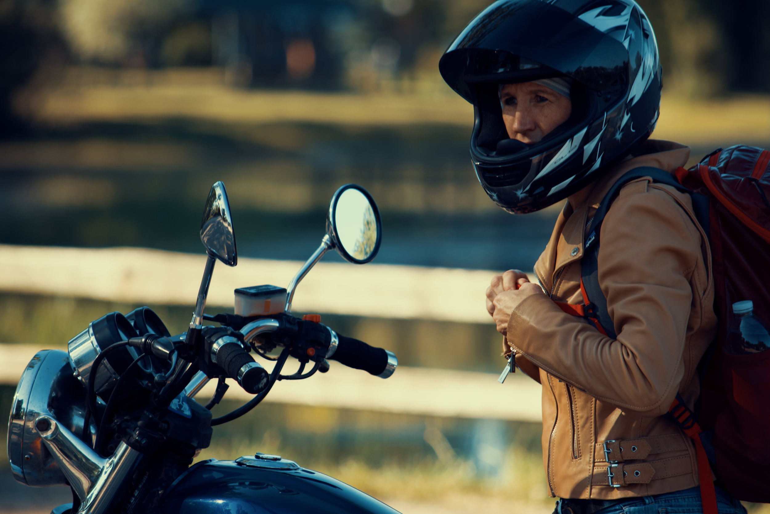 Heather strapping up to ride her motorcycle in,  Roadmap