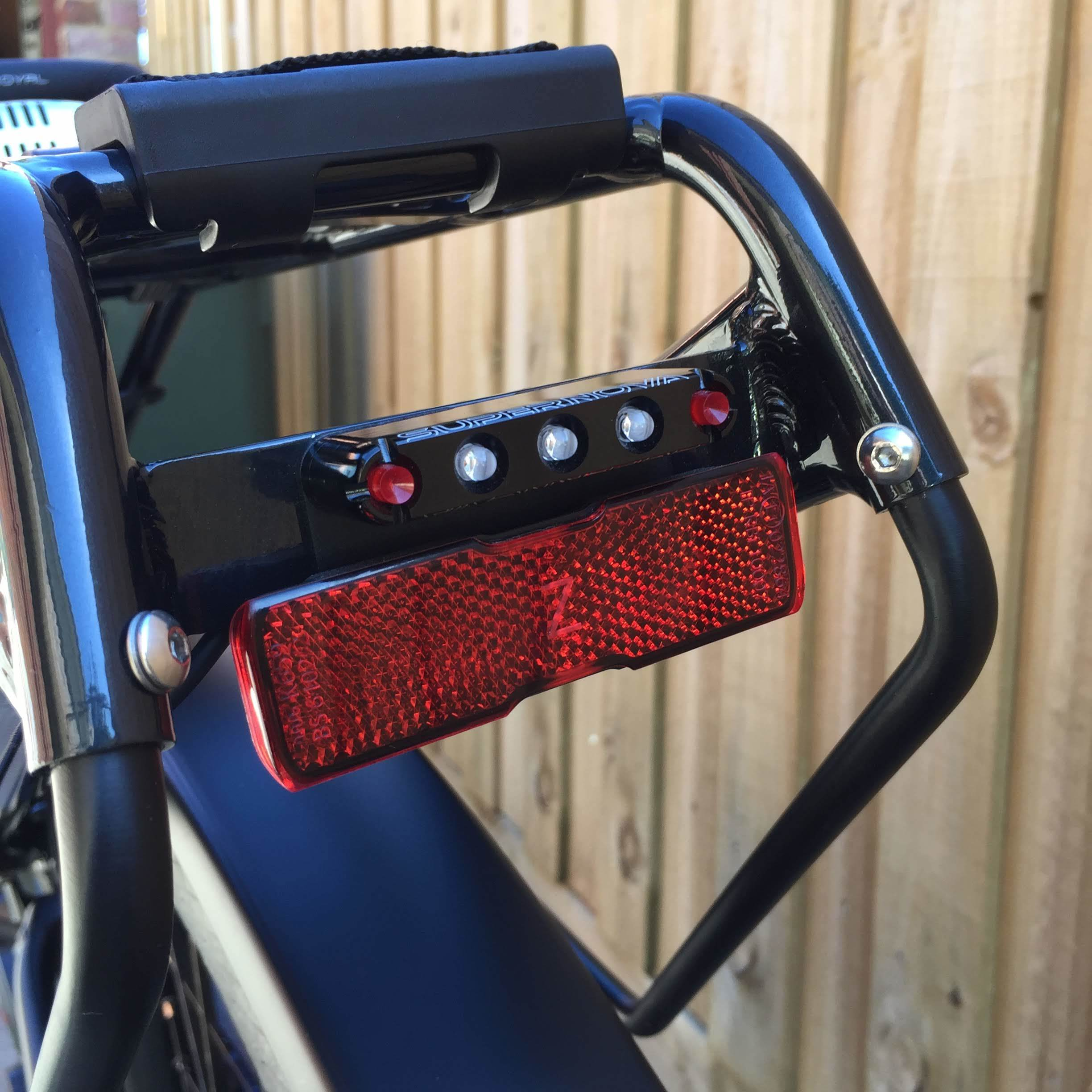 Rear reflector and LED cluster