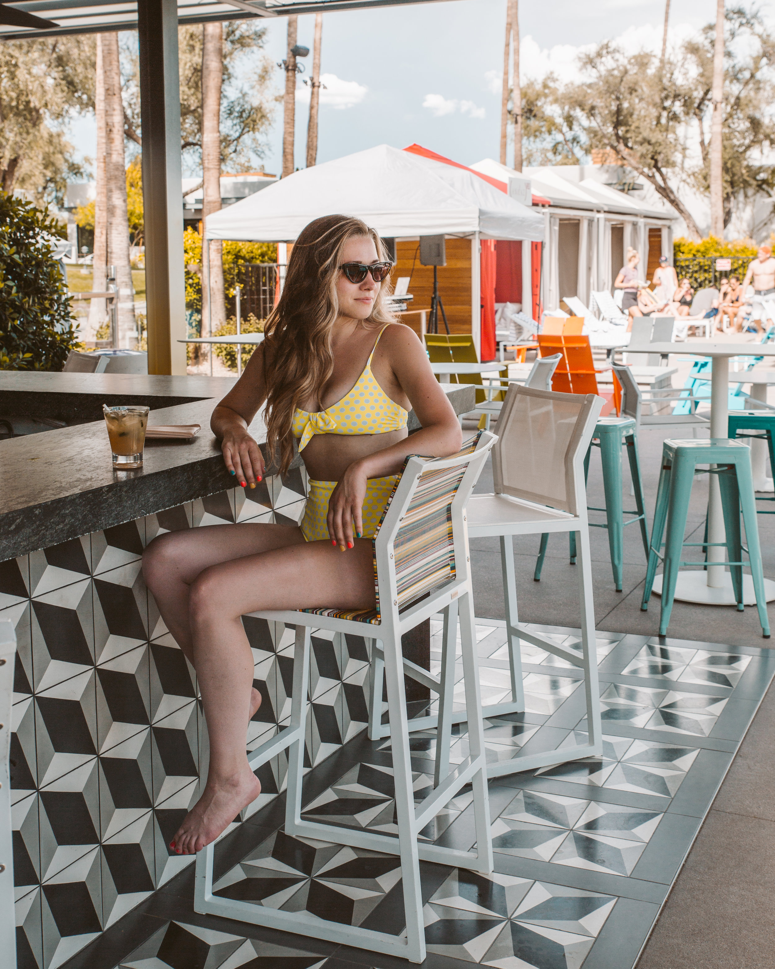 Sadie sitting at the fun poolside bar. We loved the modern look & feel of this space.