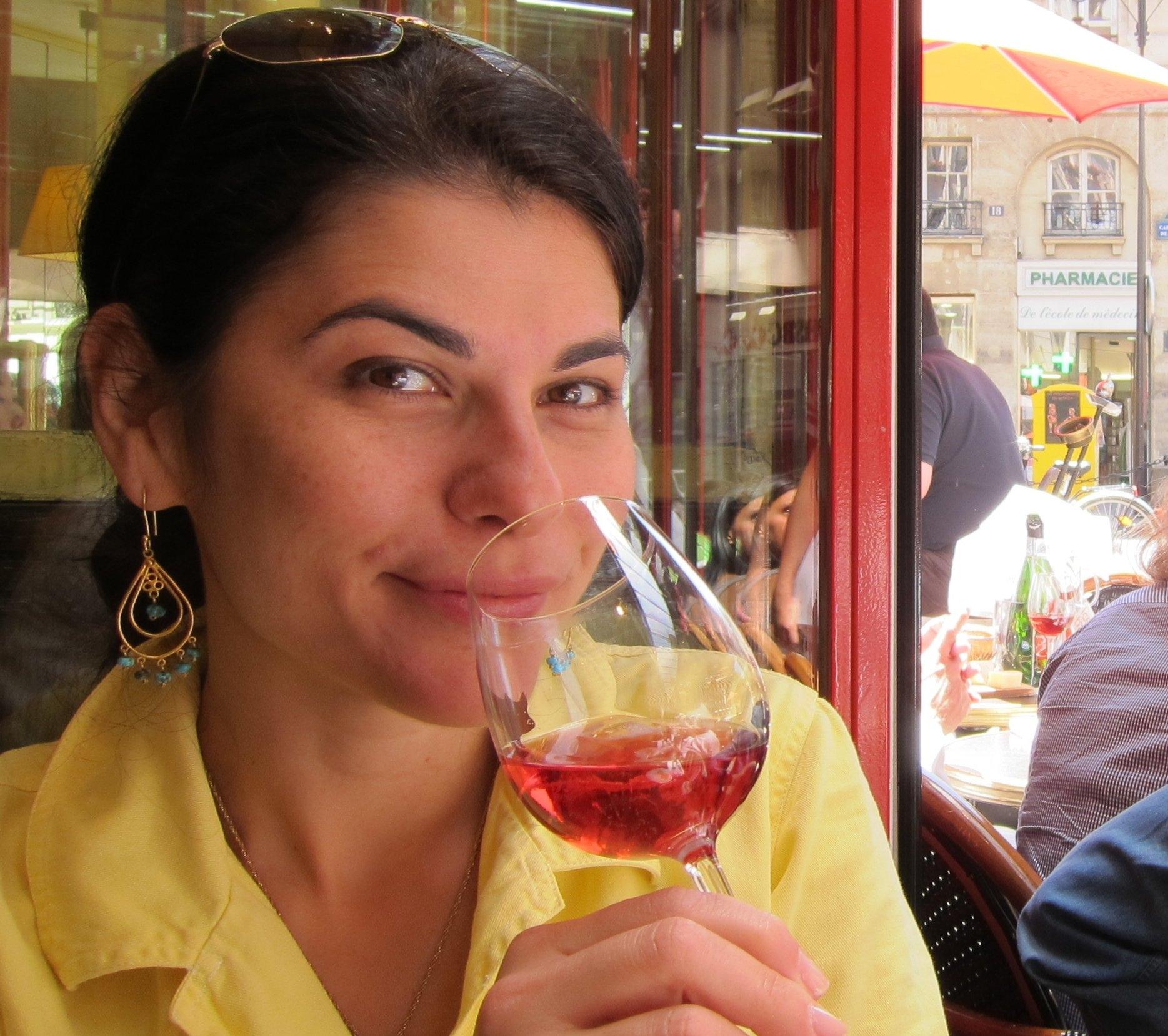 Nilou Le Comptoir yellow top sipping wine no logo.JPG