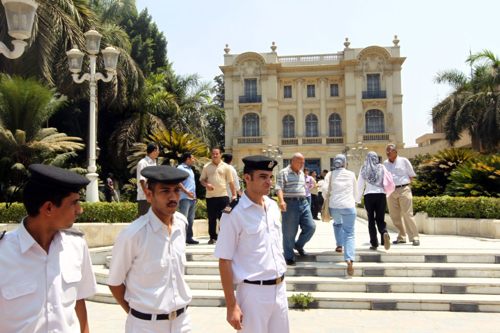 Egyptian police walk inside the grounds of the Mohammed Mahmoud Khalil Museum in Cairo on August 22, 2010, a day after a Van Gogh painting 'Poppy Flowers' valued at more than 50 million dollars was cut out of its frame and stolen. Courtesy of KHALED DESOUKI/AFP/Getty Images.