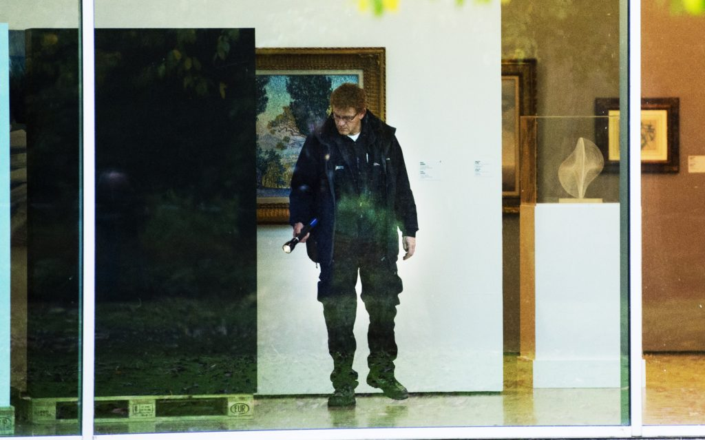 A investigator searches the Rotterdam Kunsthal museum break-in during the night on October 16, 2012. Several paintings of considerable value were stolen from Rotterdam's Kunsthal museum where works by world-renowned 19th and 20th century artists including Picasso and Van Gogh hang, police said Ocotber 16, 2012. AFP PHOTO / ANP / ROBIN UTRECHT netherlands out (Photo credit should read ROBIN UTRECHT/AFP/Getty Images)