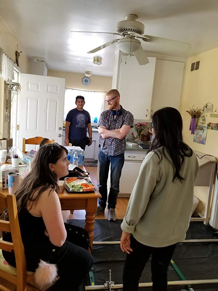 Director Landon Coats conversing with the crew