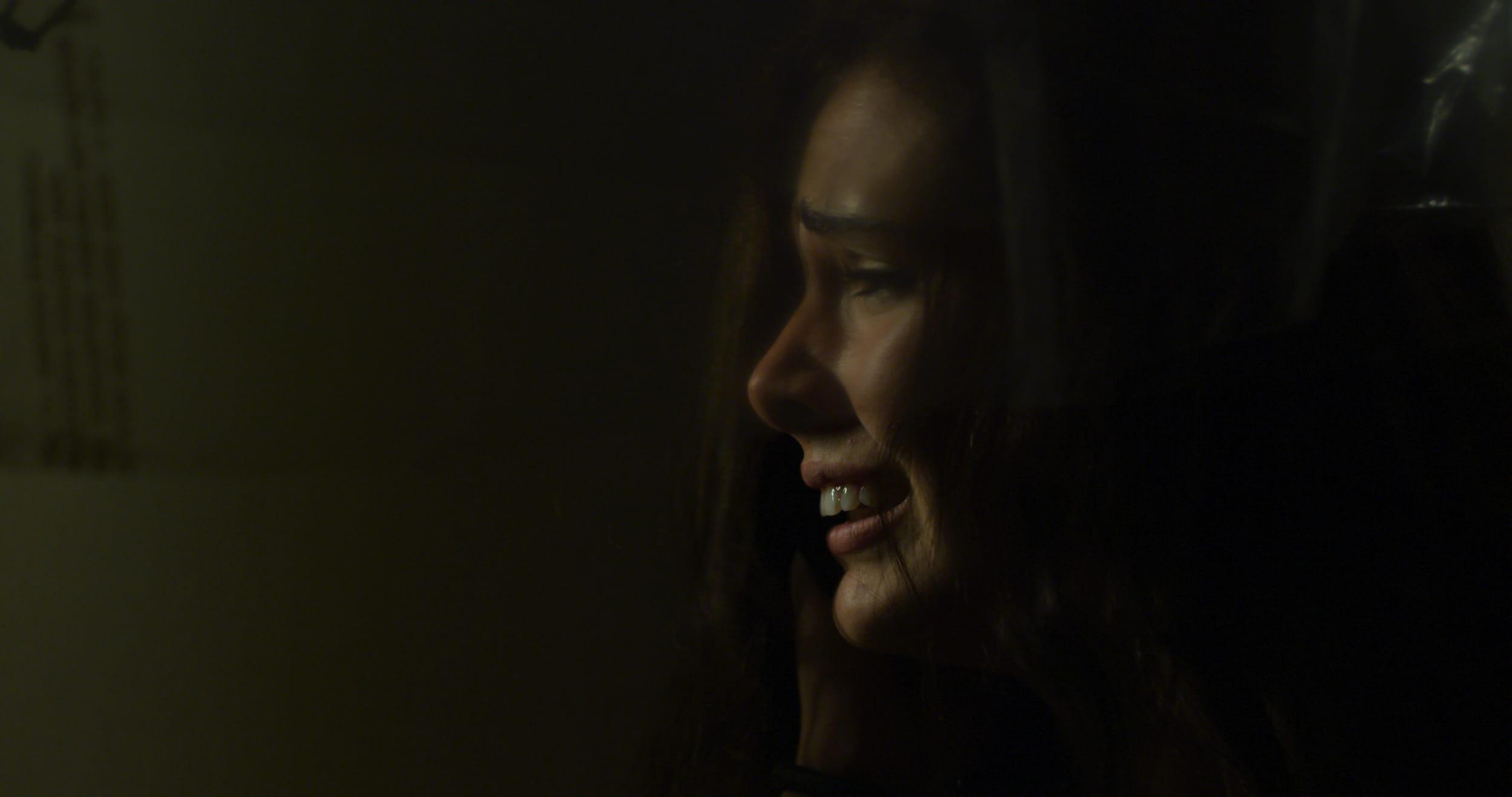 A frightened Bella hides in her closet
