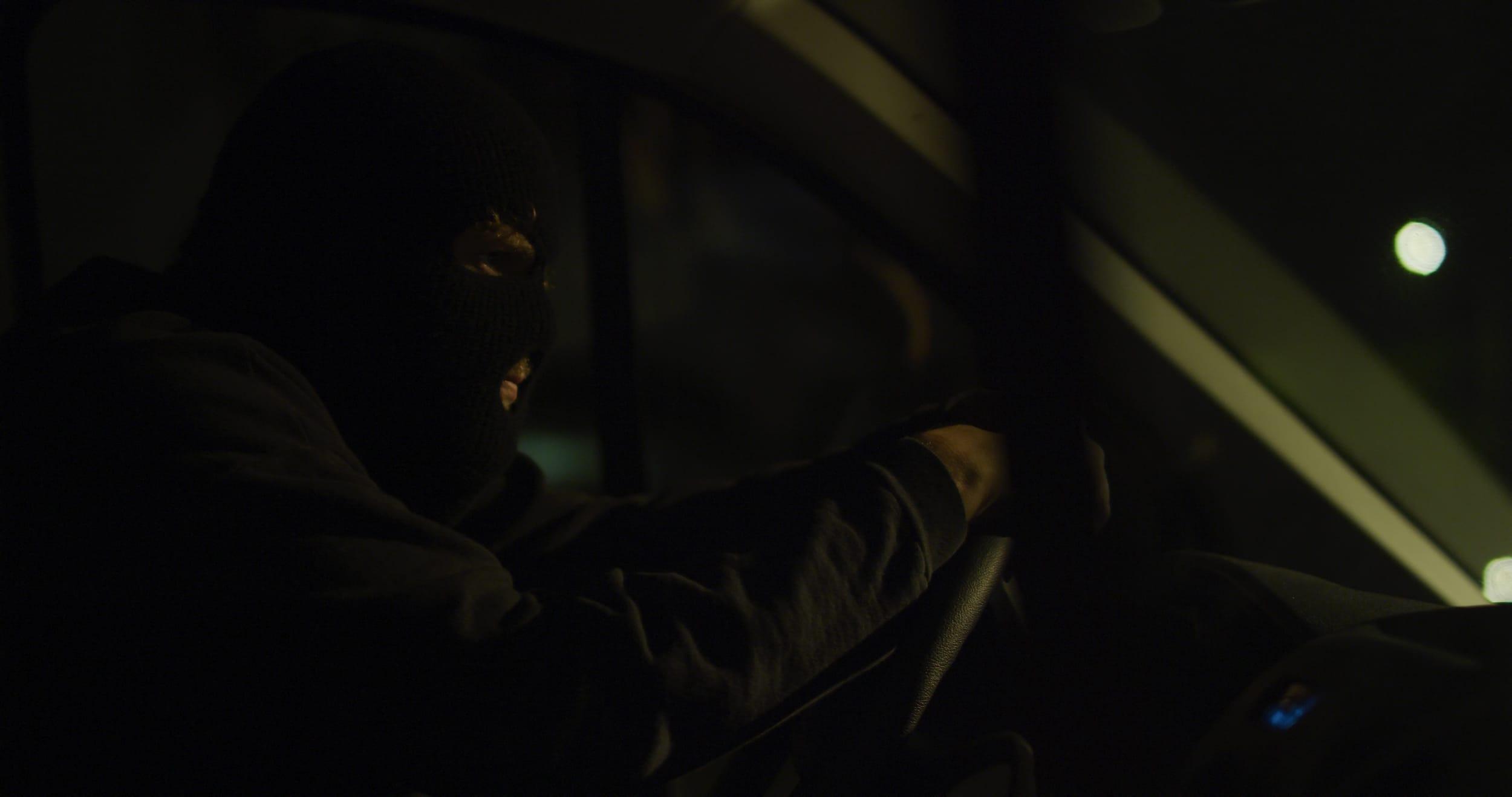 Driver waits impatiently in his van