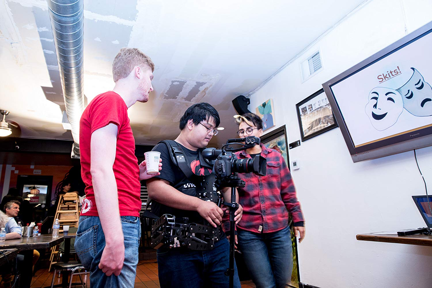 DP Eric Nguyen sets up a Steadicam shot with director Landon Coats and AC Avery Ramirez watching