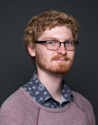 A portrait photo of director Landon Coats