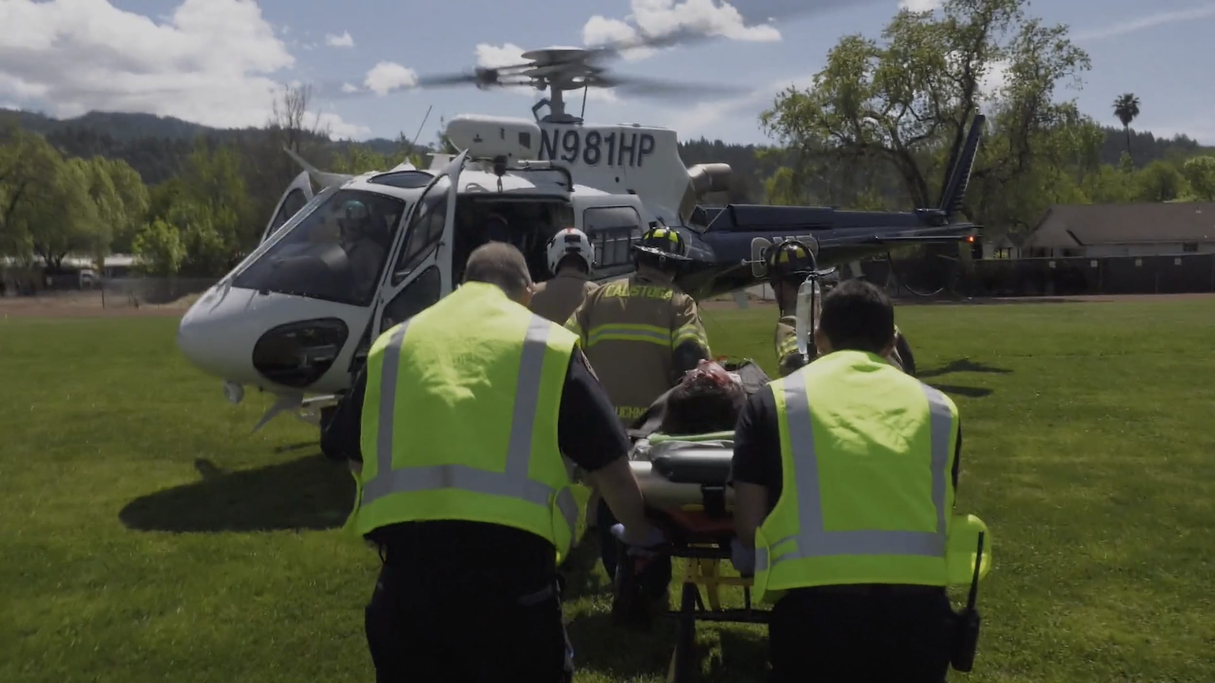 Sabrina being wheeled to an awaiting emergency helicopter