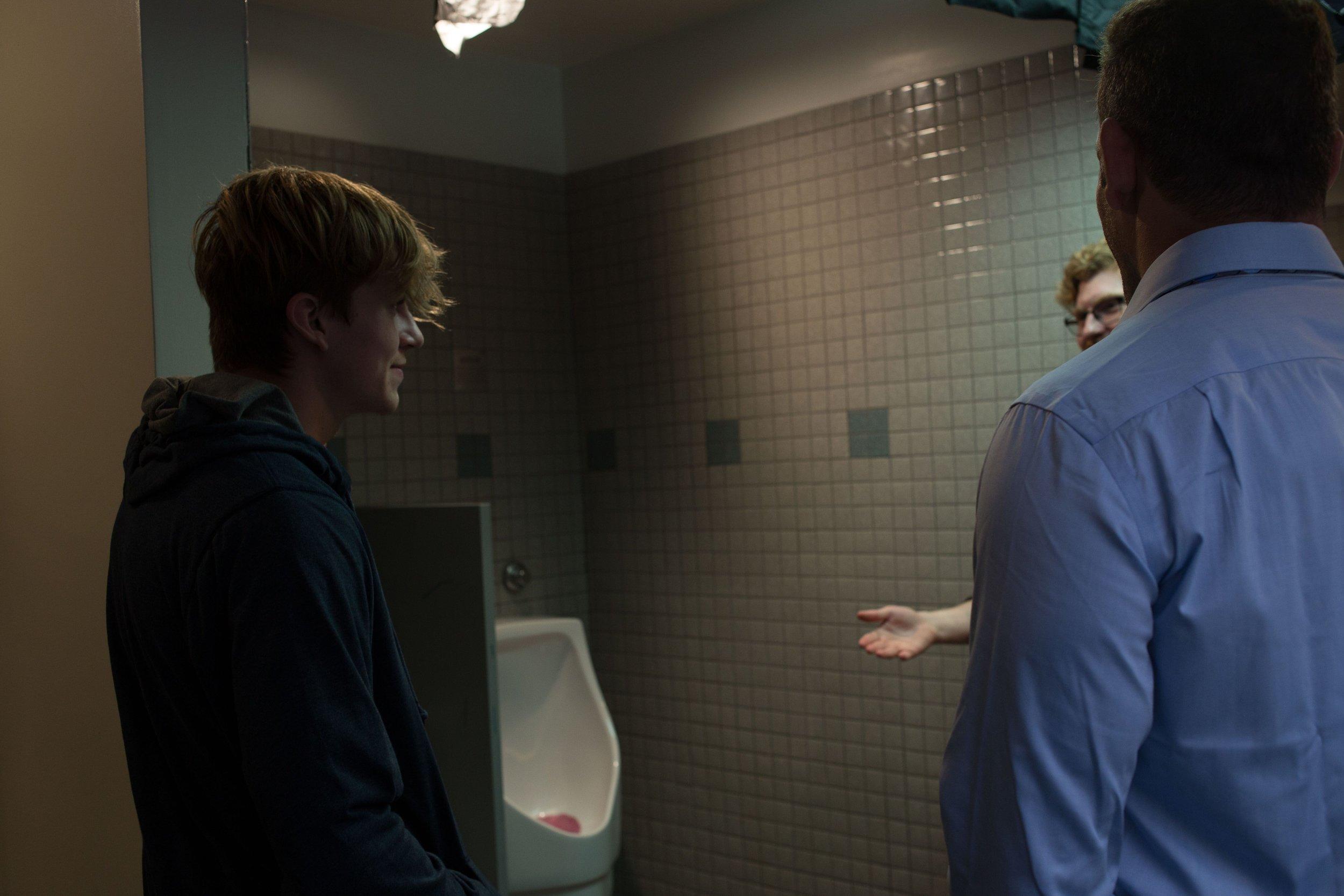 Director Landon Coats talking with Brady Lindsey and Jose Rosete