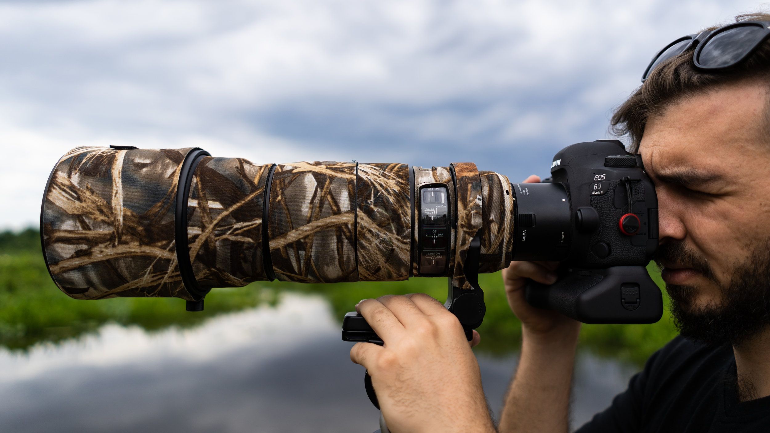 Me shooting with the massive Sigma 120-300mm F2.8 Sports DG APO OS HSM lens with a camouflage LensCoat.