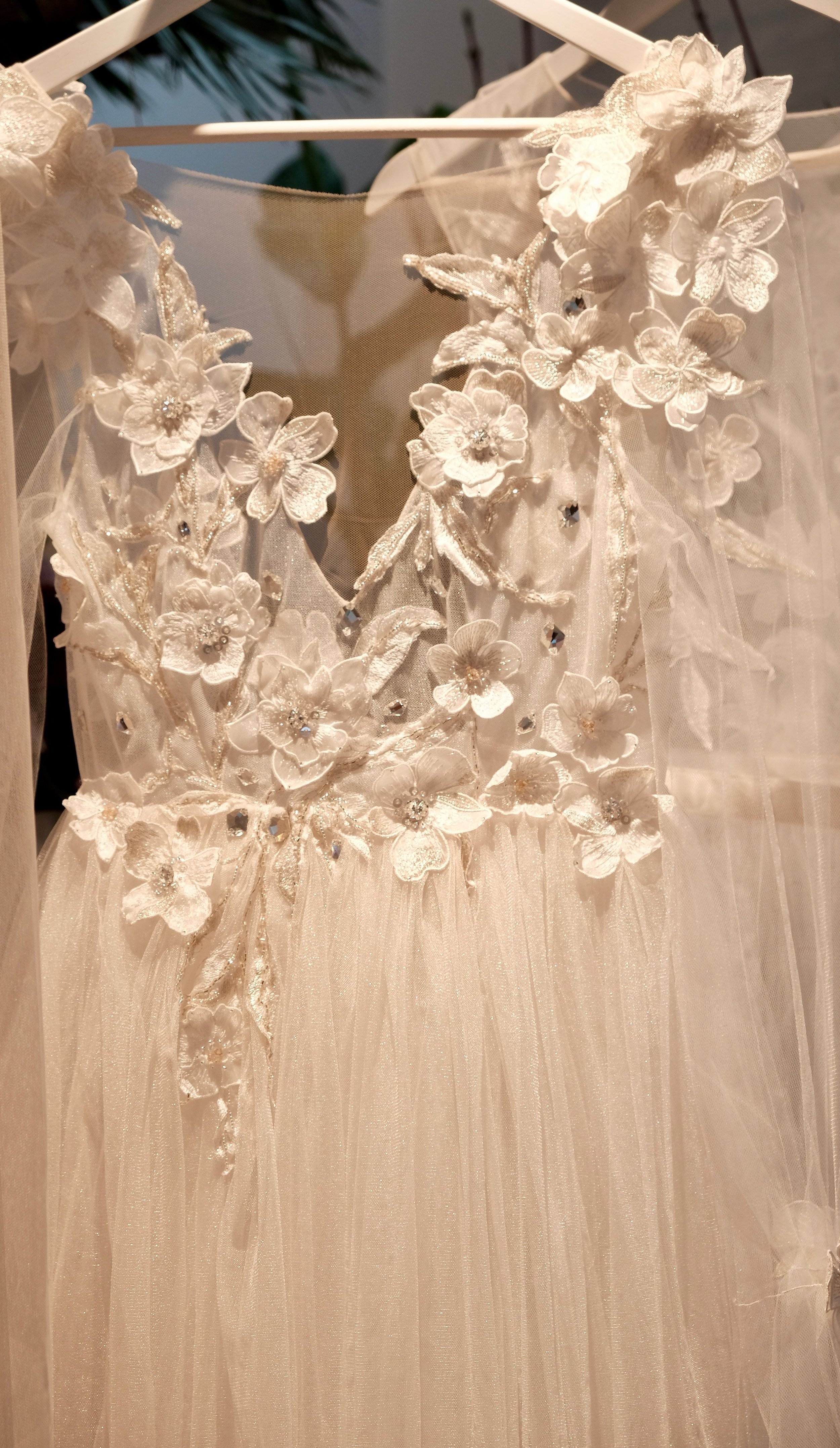 Intricate floral bridal gown (above and below) from    Ulyana Aster