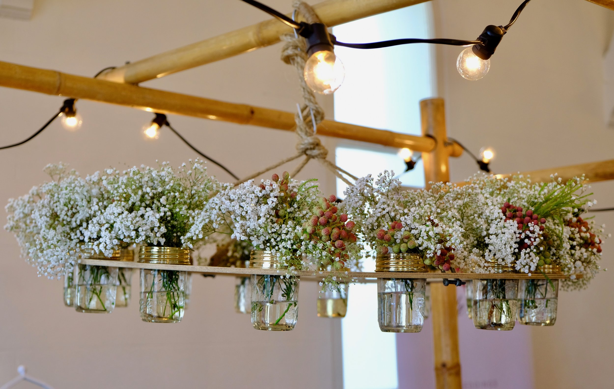 Beautiful hanging centrepiece at    Four Petits Choux   's table