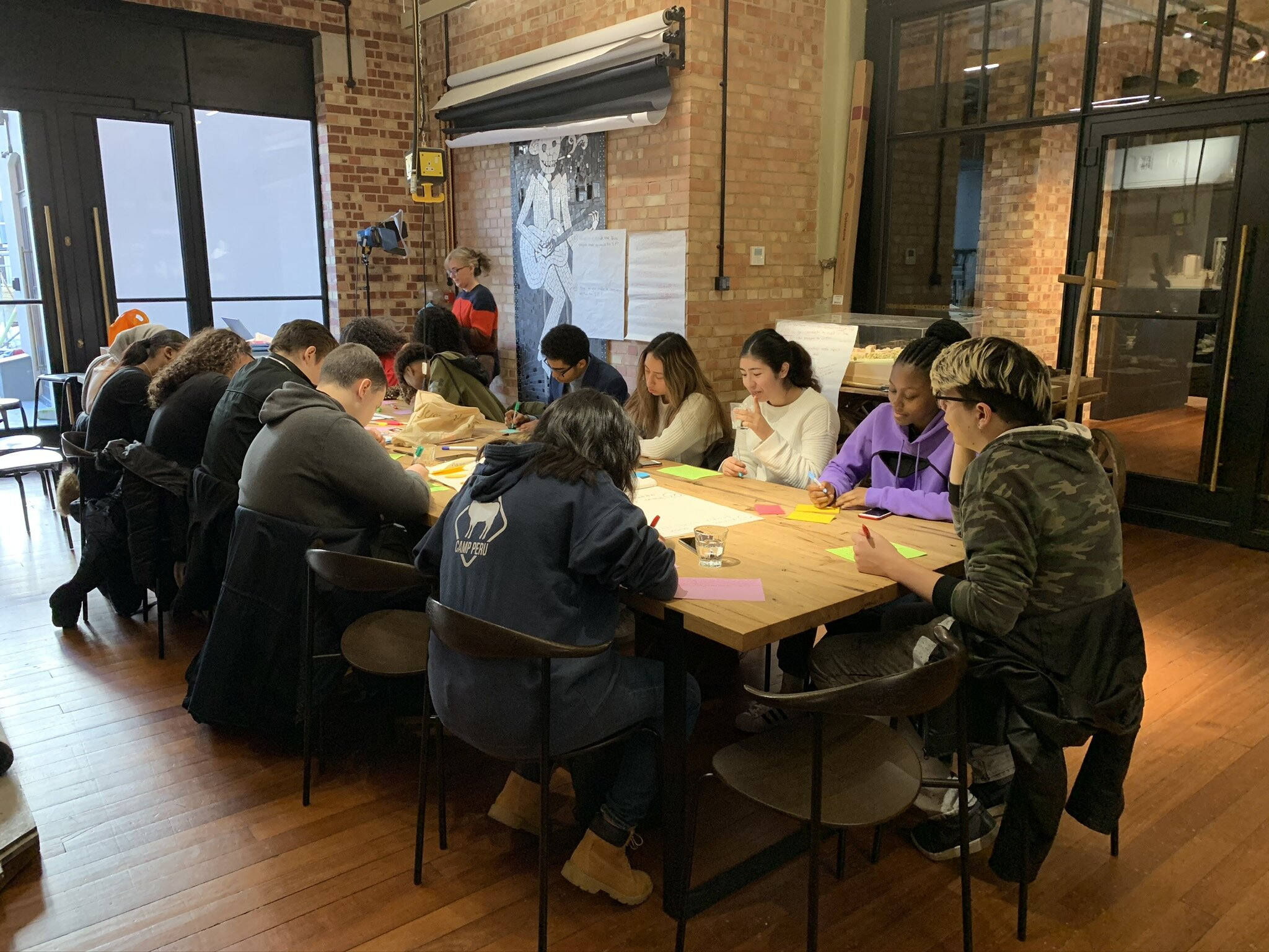 The team brainstorming their ideas. They want to lead change in their community. Thanks to Squires for letting us use their space.