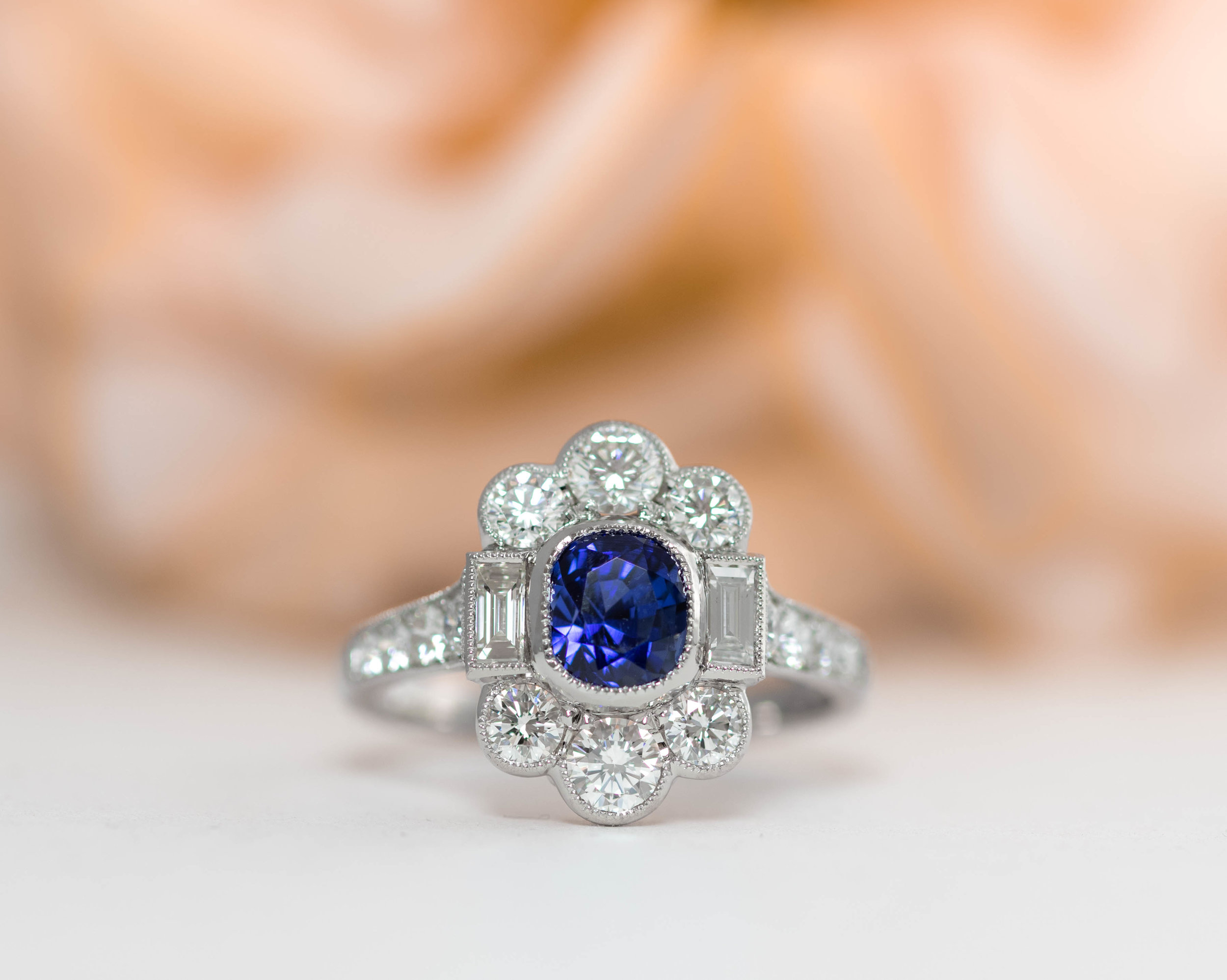 1.17ct sapphire, round and baguette diamond Art Deco cluster. Made in Chichester, England.