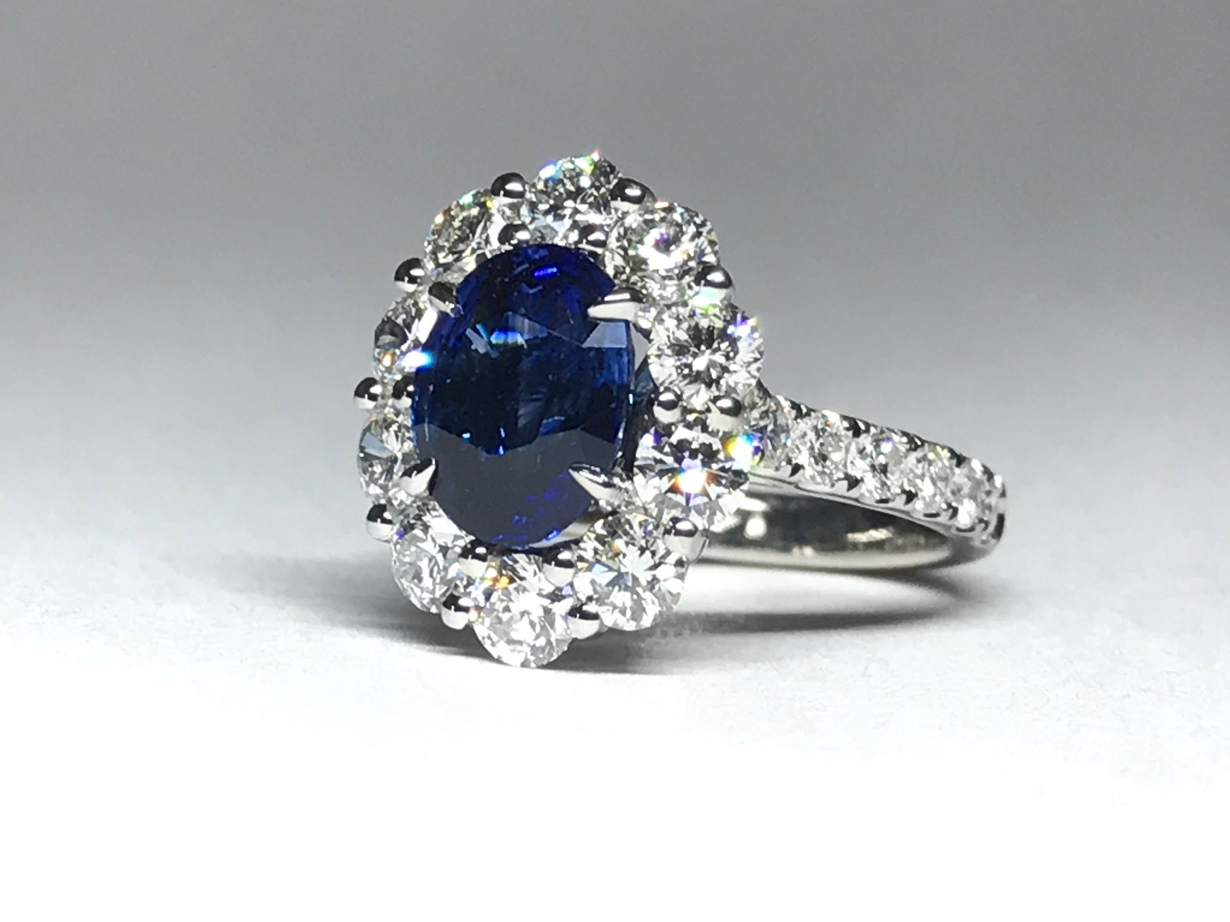 Copy of Platinum mounted 2.27ct sapphire and diamond claw set cluster. Made in Chichester, England.