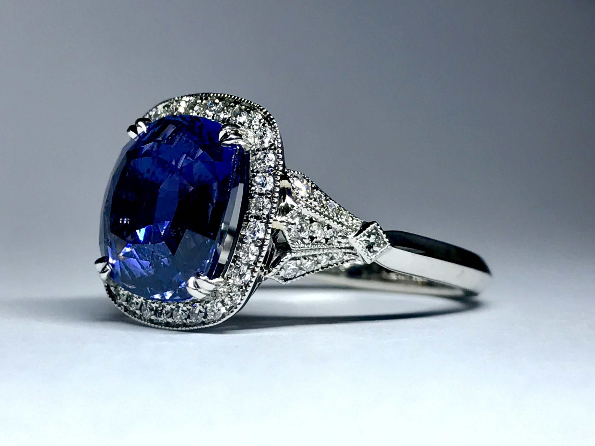 Copy of  Sapphire and diamond cluster ring. Made in Chichester, England.